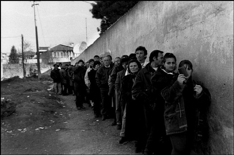 Tirana. Albanians on line applying for Greek visas.