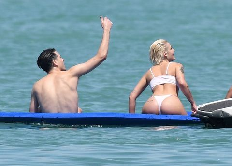 EXCLUSIVE: Singer Halsey wears a white bikini as she relaxes with boyfriend G-Eazy on a yacht in Miami