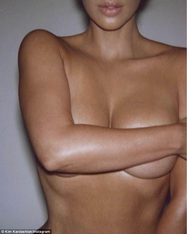 4B7FEDDF00000578-0-Kim_Kardashian_shared_a_saucy_topless_snap_on_Tuesday_showing_he-m-9_1524580455090