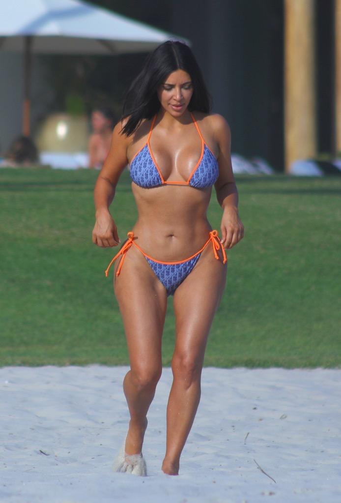 Kim Kardashian rocking a Dior 2-piece Bikini walks on the beach enjoying her all girls Mexico Vacation at Casa Aramara in Puna Mita