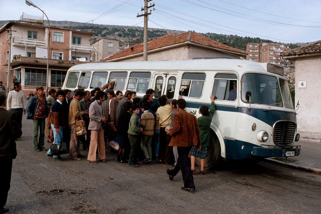 ALBANIA. Crowd gathering by a bus. 1990.