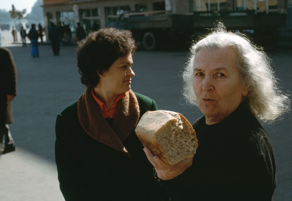 ALBANIA. Tirana. Outside the bakery, woman holding a loaf of bread.. 1990.
