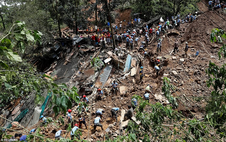 Rescuers search for people trapped in a landslide caused by Typhoon Mangkhut at a small-scale mining camp in Itogon
