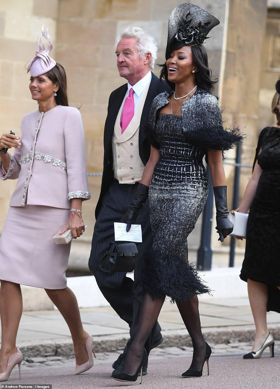 4981504-6268613-Supermodel_Naomi_Campbell_makes_her_way_into_the_wedding_of_Euge-m-32_1539335004886