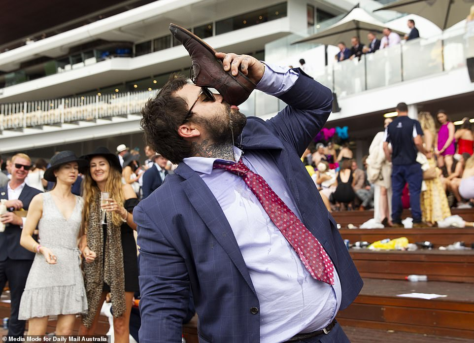 5823284-6357507-This_man_delighted_fellow_racegoers_by_tipping_his_drink_into_hi-a-31_1541497321542