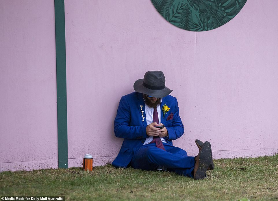 5823748-6357507-A_man_in_a_bright_blue_suit_leans_against_a_pink_wall_as_he_fini-a-40_1541497322154