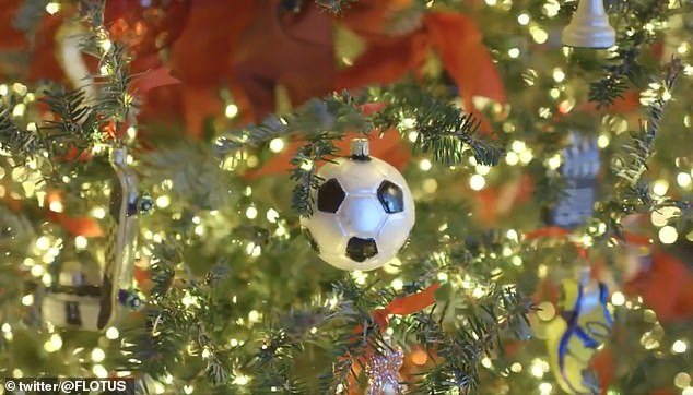 6657870-6436439-One_of_the_smaller_trees_in_the_White_House_features_a_soccer_ba-a-24_1543386667758