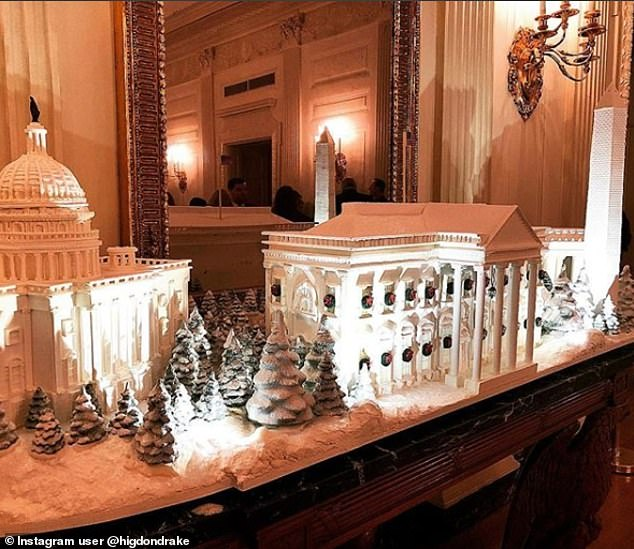 6727360-6436439-To_set_it_all_off_a_miniature_White_House_was_on_display_on_one_-a-82_1543378851378