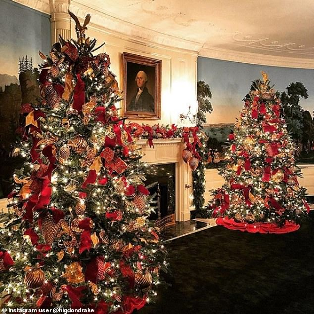 6727366-6436439-Two_Christmas_trees_framed_a_fireplace_situated_below_a_mantle_t-a-74_1543378671326