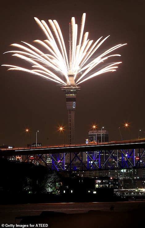 7983756-6541611-Fireworks_explode_from_the_Sky_Tower_during_Auckland_s_New_Year_-m-82_1546257254721