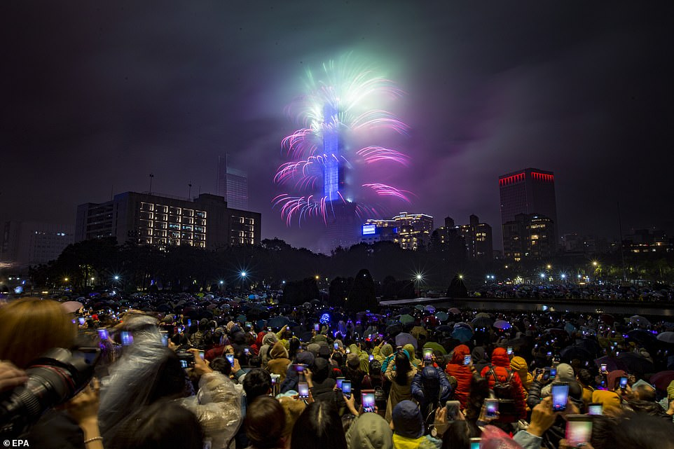 7992614-6541611-Fireworks_and_lights_were_seen_illuminating_the_night_sky_at_Tai-a-4_1546302680911