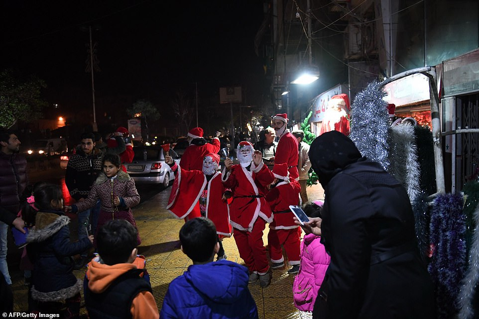 7997518-6541611-SYRIA_Syrians_dressed_as_Santa_Claus_greeted_people_on_the_stree-a-35_1546302686534