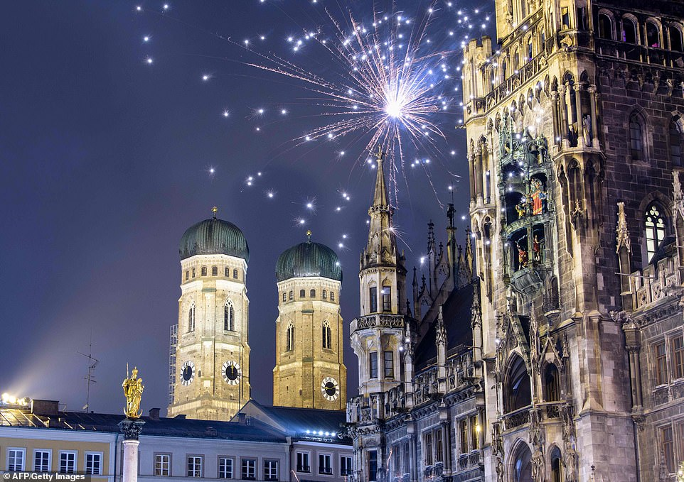 7997598-6541611-GERMANY_Fireworks_illuminated_the_sky_above_Marienplatz_in_Bavar-a-37_1546302687075