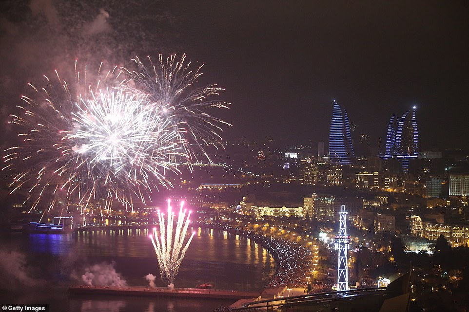 7998206-6541611-AZERBAIJAN_Fireworks_lit_up_the_sky_in_Baku_as_the_celebrated_th-a-44_1546302688366