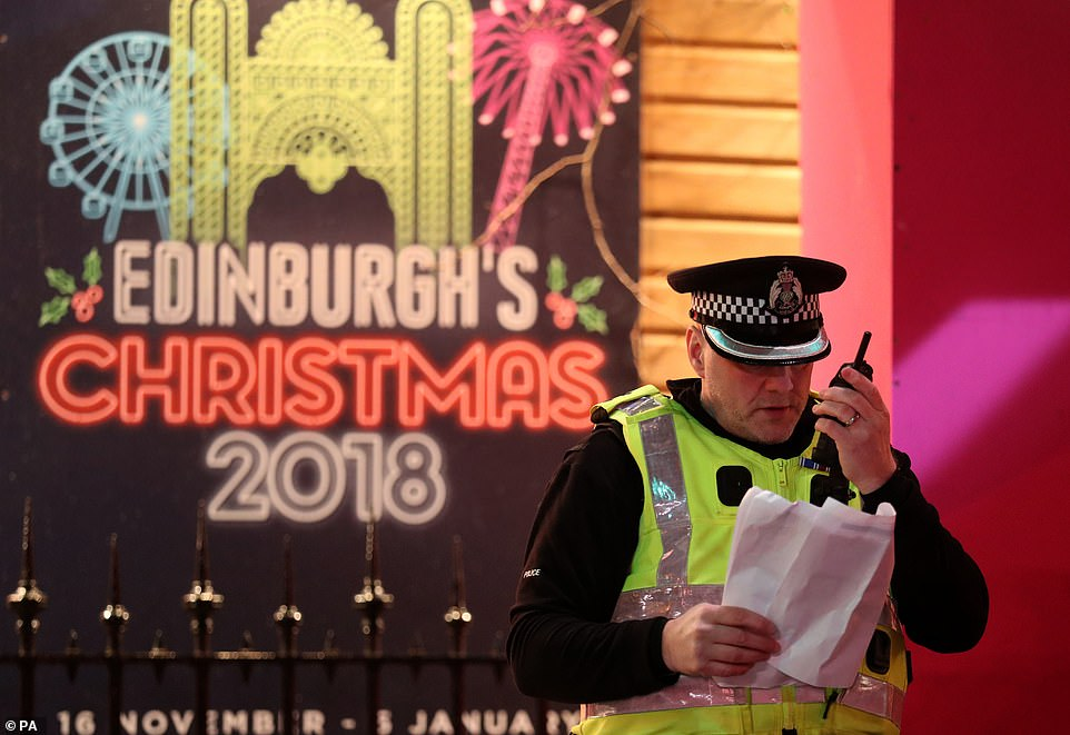 7998898-6541611-EDINBURGH_As_the_festive_celebrations_continued_police_officers_-a-43_1546302687703