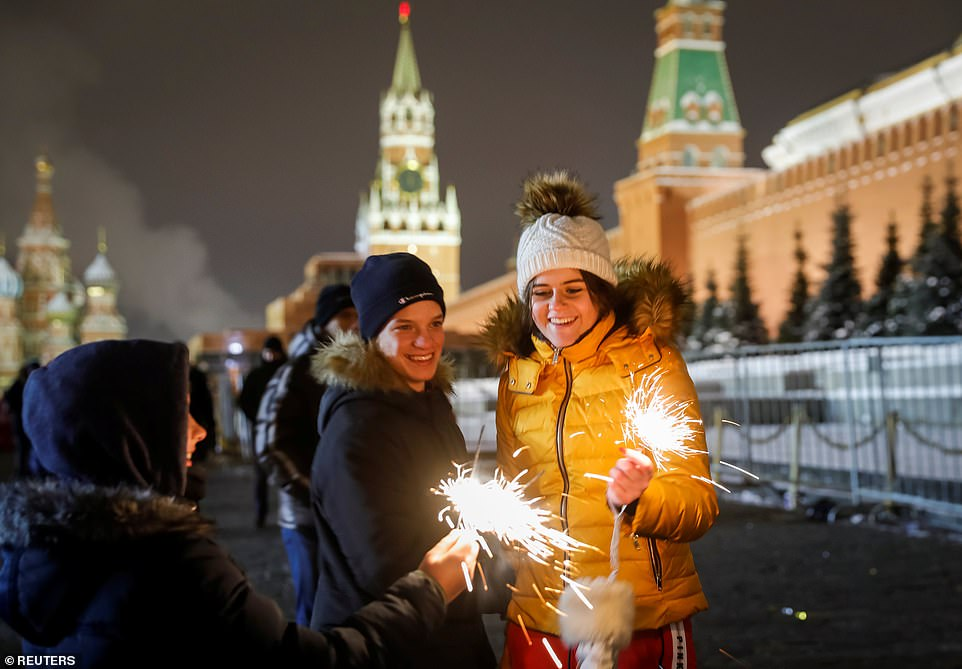7999030-6541611-MOSCOW_Revellers_light_sparklers_as_they_enjoy_New_Year_s_day_ce-a-1_1546302679420