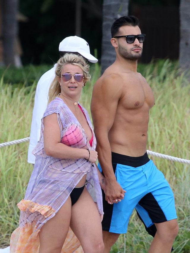 Britney Spears wears a pink bikini as she takes a jet ski ride with boyfriend Sam Asghari on the beach in Miami